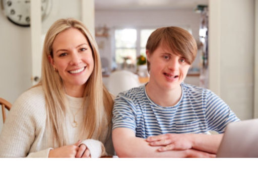 adult woman and teenager man smiling