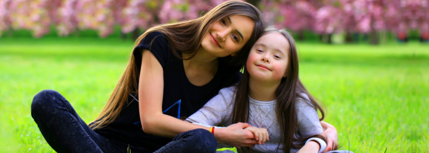 adult woman and little girl smiling